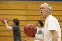 Mr. Huber looks to his teammates during the March Madness student and teacher tournament.