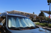 Many cars in the parking lot used reflective sunshades to keep the car cool. By Clare Fonstein